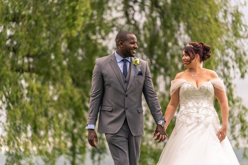 wedding photos - bride and groom walk hand in hand