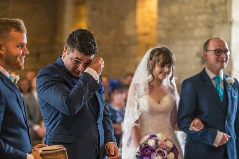 candid wedding photography - a groom cries