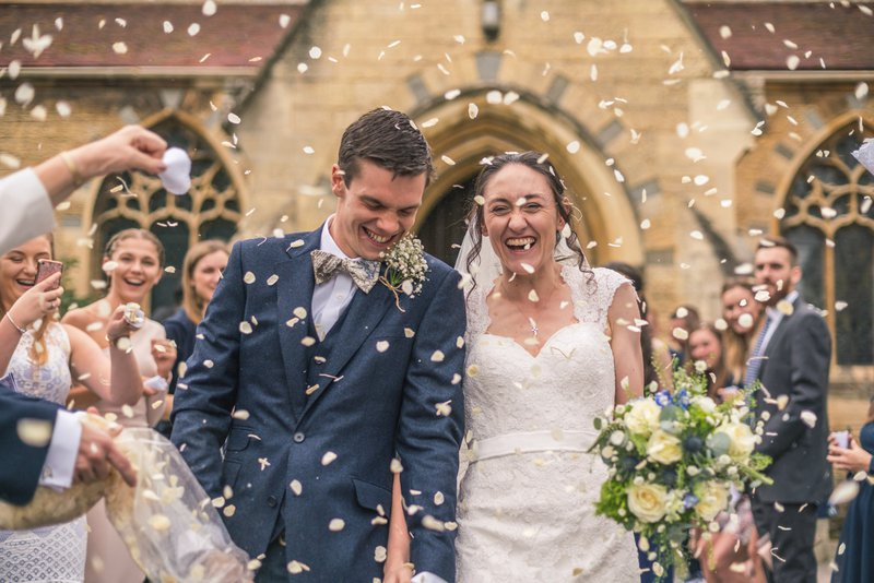 professional wedding photographer - bride and groom and confetti